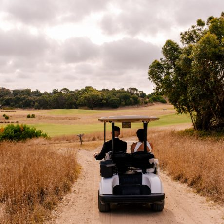 Romatic wedding in the golf carts over the golf course